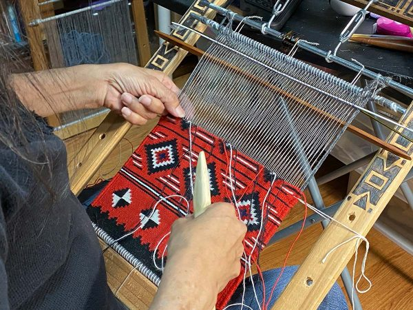 Barbara Teller Ornelas working on her loom