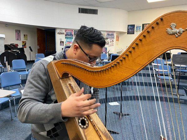 Adrian Perez with his harp