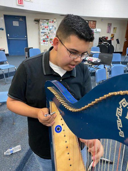 Ivan Miranda with his harp