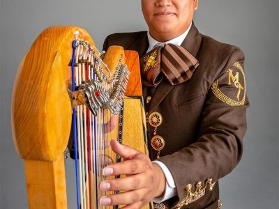 Adrian Perez with harp; photo by Steven Meckler